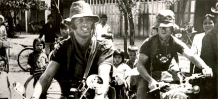 Sean Flynn and Dana Stone heading out on motorcycles to the Cambodia-Vietnam border, 04/06/70. (photo: Stephen Bell)