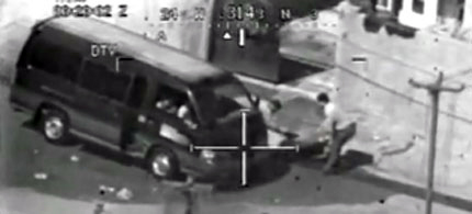 A video frame from the WikiLeaks US Apache helicopter video shows wounded civilians being loaded into a van moments before the Apache gun-crew opened fire, 07/13/07. (photo: Apache Crew/WikiLeaks)