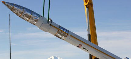 A ground-based missile interceptor is lowered into its missile silo during a recent emplacement at the Missile Defense Complex at Fort Greely, Alaska.  (photo: DOD)