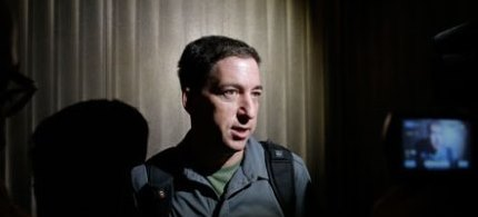 Glenn Greenwald speaks to reporters in Hong Kong where he interviewed the NSA whistleblower Edward Snowden. (photo: Vincent Yu/AP)