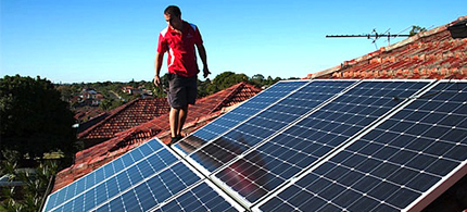A battle between public utilities and rooftop solar power companies is brewing. (photo: EcoWatch)