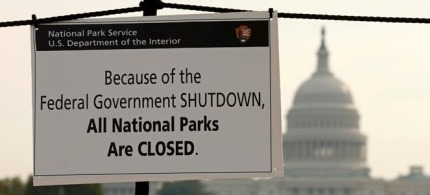 The U.S. Capitol looms in the background of a sign on the National Mall reminding visitors of the closures to all national parks due to the federal government shutdown in Washington October 3, 2013.  (photo: Reuters/Kevin Lamarque)
