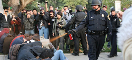 Lt. John Pike of the UC Davis police sprays UC Davis protesters. (photo: Louise Macabitas)