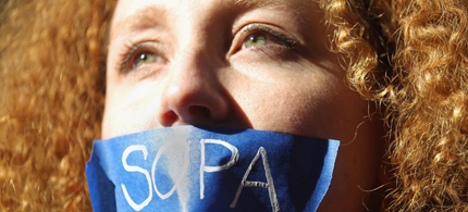 A protester demonstrates against the proposed Stop Online Piracy Act (Sopa) in New York. It might be time to do the same against the Trans-Pacific Partnership. (photo: Mario Tama/Getty Images)