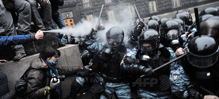 Protesters use tear gas and throw stones during clashes with riot police in front of the Cabinet of Ministers of Ukraine during a rally in Kiev on November 24, 2013. (photo: Genya Savilov/AFP)