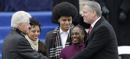 Former President Bill Clinton administers the oath of office to Mayor-elect Bill de Blasio as his wife Chirlane McCray, second from right, Dante de Blasio, center, and Chirlane McCray watches on the steps of City Hall Wednesday, Jan. 1, 2014, in New York. (photo: Frank Franklin II/AP)