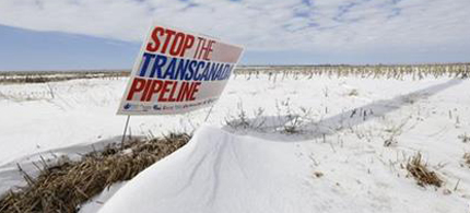 A Nebraska district court struck down a law that allowed the Keystone XL oil pipeline to proceed through the state, the law could have been used to force landowners to allow the pipeline on their property. (photo: Nati Harnik/AP)