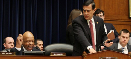 Rep. Darrell Issa leaves as Rep. Elijah Cummings gives his statement. (photo: Lauren Victoria Burke/AP)