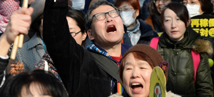 People shout slogans as they march during an anti-nuclear power plant demonstration in Tokyo. (photo: AFP)