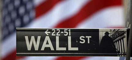 The Wall Street sign is seen outside the New York Stock Exchange, March 26, 2009. (photo: Chip East/Reuters)