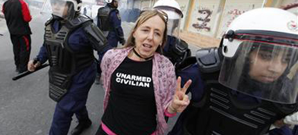 US activist Medea Benjamin is arrested by women riot police during her participation in a march to Al Farook Junction in 2012. (photo: Hamad)