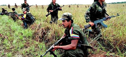 Soldiers of the guerrilla group the Revolutionary Armed Forces of Colombia (the Farc). (photo: Sipa Press/Rex Features)