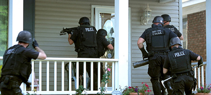 Police raiding a house. (photo: Alamy Images)