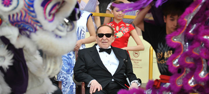 Chairman and CEO of Las Vegas Sands Corporation Sheldon Adelson watches a lion dance at the opening ceremony of the Sands Cotai Central in April 2012 in Macau. (photo: Aaron Tam/AFP/Getty Images)