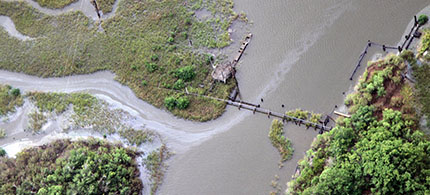 A pipeline in a coastal marsh in Louisiana. (photo: NPR/Gulf Restoration Network)