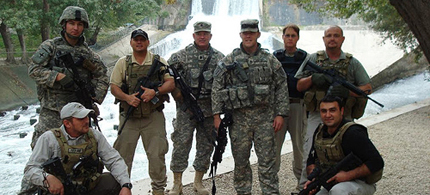 Dyncorp contractors pose with soldiers. (photo: Tim Patterson)