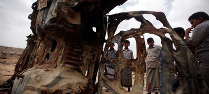 The wreckage of a car destroyed by a U.S. drone strike in Azan, Yemen, February 2013. (photo: Khaled Abdullah/Reuters)