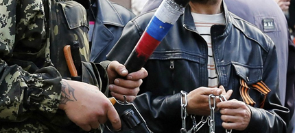 Pro-Russian rebels with baseball bats, chains and handguns. (photo: BBC)