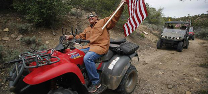 Activists seeking to directly challenge federal control of swathes of territory in the U.S. West embark on an all-terrain vehicle ride on Saturday across protected land in Utah that is home to Native American artifacts and where such journeys are banned. (photo: Jim Urquhart/Reuters)