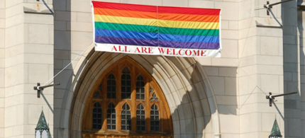 A banner welcomes LGBT people to a Presbyterian church. (photo: Ivan Cholakov/Shutterstock)