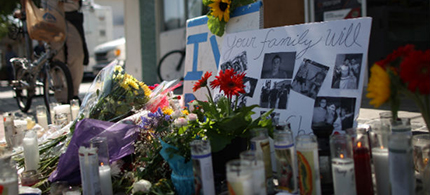 A makeshift memorial stands in front of the IV Deli yesterday i