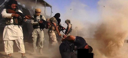 An image made available by the Jihadist Twitter account al-Baraka news on June 16, 2014 allegedly shows ISIS militants executing members of the Iraqi forces on the Iraqi-Syrian border. (photo: AFP)