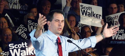Governor Scott Walker of Wisconsin celebrating the defeat of his recall after one of his wealthy supporters voted five times. (photo: AP)