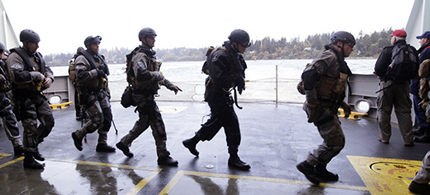 During a drill, SWAT team members prepare to secure a ship in Bainbridge Island, Washington. (photo: Elaine Thompson/AP)