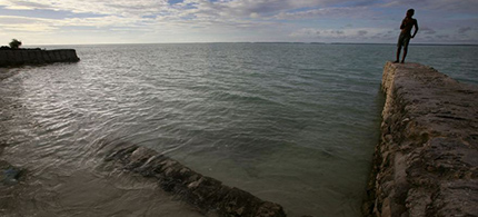 Sea walls like these haven't been enough to stop the steady rise of the seas around Kiribati. (photo: Reuters/David Gray)