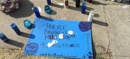 A sign at the memorial for Ezell Ford in South LA. (photo: The Huffington Post)