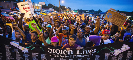 Ferguson protesters behind banner with names of young people killed by the police. (photo: Scott Olson/Getty Images)