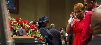 Lesley McSpadden at the casket of her son Michael Brown at the Friendly Temple Missionary Baptist Church in St. Louis, Missouri. (photo: Richard Perry/Reuters)