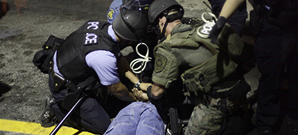 Police in riot gear detain a demonstrator in Ferguson, Missouri, August 19, 2014. (photo: Reuters/Joshua Lott)