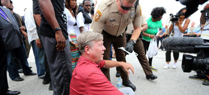 Larry Rice is arrested by a St. Louis County Police officer during a demonstration on Hanley Road at Interstate 70 in St. Louis County on Wednesday, Sept. 10, 2014. (photo: David Carson/post-dispatch)