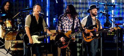 Bruce Springsteen, Dave Grohl and the Zac Brown Band playing John Fogerty's 'Fortunate Son' at the Concert for Valor on Veteran's Day. (photo: Carolyn Kaster/AP)