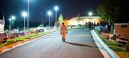 A man walks in the parking lot of a voting center in Raleigh, North Carolina. (photo: Zach D. Roberts/Al Jazeera America)