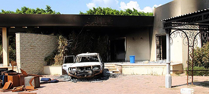 A burnt house and a car are seen inside the US Embassy compound on September 12, 2012 in Benghazi, Libya. (photo: AFP)