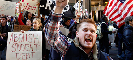 Keegan O'Brien, of Boston, front, joins with members of the Occupy Boston movement, students from area colleges, and union workers as they display placards and shout slogans during a march through downtown Boston in 2011. (photo: AP/Steven Senne)