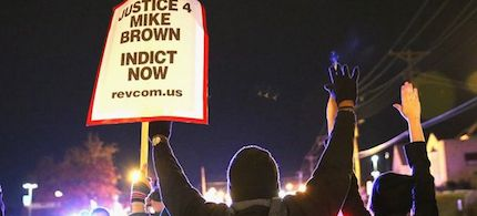 Demonstrators are confronted by police as they block a street during a protest ahead of the grand jury announcement on November 24, 2014 in Ferguson, Missouri. (photo: Scott Olson/Getty Images)