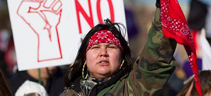 One of the 1,000 Idle No More protesters who gathered on the Ambassador Bridge in Windsor, Ontario, last January and blocked traffic for several hours. (photo: Geoff Robins/AP)