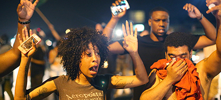 Demonstrators protesting the killing of teenager Michael Brown by a Ferguson police officer try to stand their ground despite being overcome by tear gas in Ferguson, Missouri. (photo: AFP/Getty Images/Scott Olson)