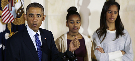 President Obama and his daughters. (photo: Jacquelyn Martin/AP)