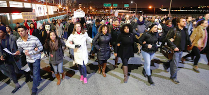 People march in protest on the West Side Highway after it was announced that the New York City police officer involved in the death of Eric Garner was not indicted, Wednesday, Dec. 3, 2014, in New York. (photo: Julio Cortez/AP)