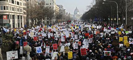 Demonstrators fill Pennsylvania Avenue as they march towards the U.S. Capitol building during the national Justice For All march against police violence in Washington December 13, 2014. (photo: Reuters/Jim Bourg)
