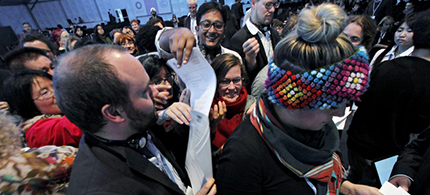 Delegates receive copies of The Lima Call for Climate Action after its approval at the 20th UN climate change conference in Lima, Peru. (photo: EPA)