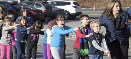 Children being evacuated from Sandy Hook Elementary. (photo: Shannon Hicks/Newton Bee)