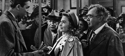 James Stewart, left, Thomas Mitchell, right, and Donna Reed appear in the 1946 movie 'It's A Wonderful Life.' (photo: AP)