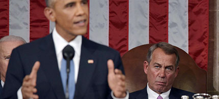 US Speaker of the House John Boehner listens as US President Barack Obama delivers the State of the Union address. (photo: Mandel Ngan/Bloomberg)