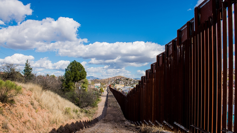 The border wall in Nogales, Arizona is heavily guarded and effective at keeping migrants out. (photo: Felix Gaedtke/Al Jazeera)