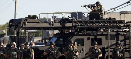 Ferguson police using military equipment to crack down on the community's protests. (photo: ivn.us)